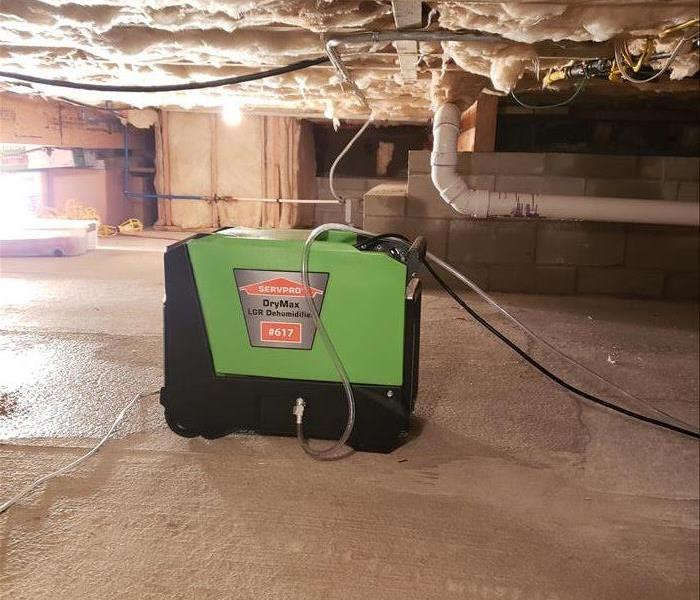 Drying equipment setup in flooded crawlspace