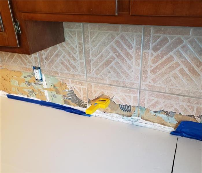 Water damaged wall behind kitchen counter