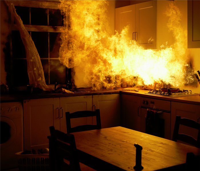a kitchen with a fire raging by the stove