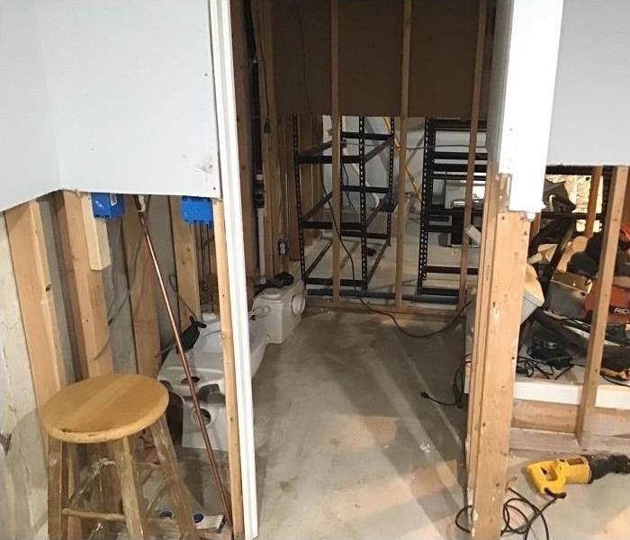 basement water damage, flood cuts along wall